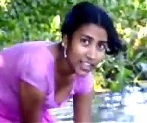 village girl bathing in..