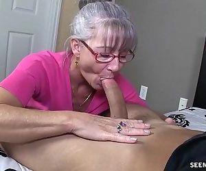 Horny Granny Sucks A..