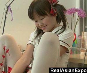 Petite Asian Orgasming..