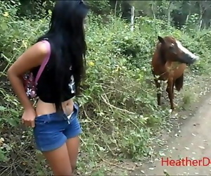HD peeing next to horse..
