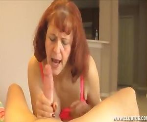 Mature woman jerking a..