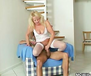 Blonde granny jumps on..
