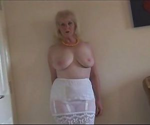 Mature busty lady in..