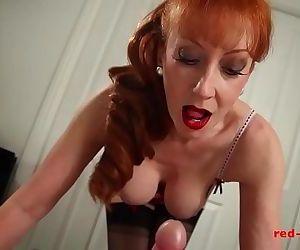Horny big tit redhead..