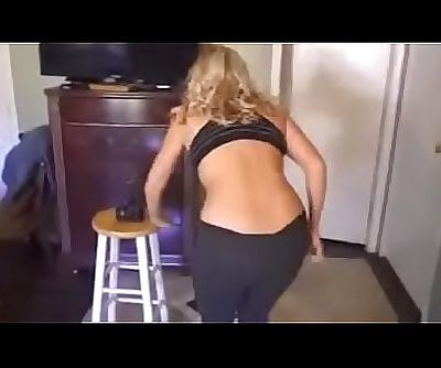 Son helping his mom to..